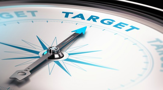 Compass needle pointing the word target. Concept of measurable outcomes and customized solutions.