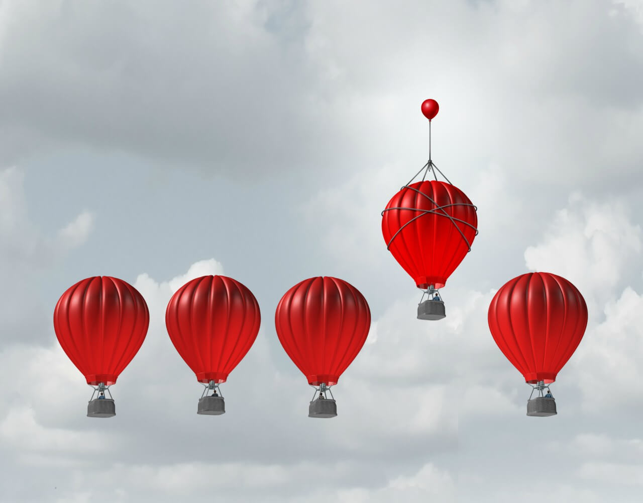 Competitive edge and business advantage concept as a group of hot air balloons racing to the top but an individual leader with a small balloon attached giving the winning competitor an extra boost to win the competition.